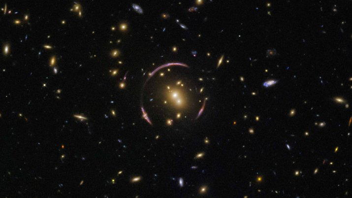 """A Light Distorting """"Einstein Ring"""" Discovered By The Hubble Telescope In Distant Galaxy Cluster"""